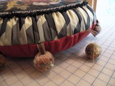"""Kathleen Mullaney """"Vintage needlepoint pieces made into pillows. I love making pompoms"""""""