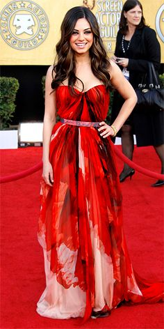 (more volume in the bottom, some accessory in blue/green) Mila Kunis in ALEXANDER McQUEEN. that hair.