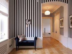 Striped wallpaper. I like this look a lot but I wonder if I would get tired of it quickly