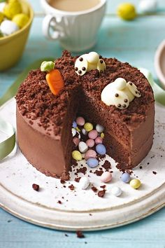 884682b5e414 Try the Waitrose Burrowing Bunnies Pinata Cake and impress guests with this  charming, chocolatey cake