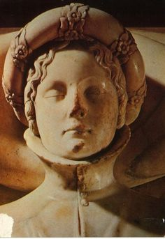 Lucca, Ilaria Del Carretto. The face of Ilaria del Carretto from her tomb, sculpted by Jacopo della Quercia. Ilaria del Carretto (1379 – 8 December 1405) was an Italian noblewoman and the second wife of Paolo Guinigi, the lord of Lucca from 1400 to 1430. She died in Lucca at the age of twenty-six after giving birth to her daughter. Her marble sarcophagus is now located in the Cathedral of San Martino in Lucca. She reclines peacefully with a dog, symbol of fidelity, at her feet.