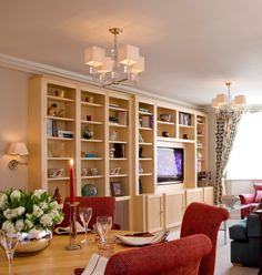 Bespoke Maple Joinery bookcase with space for the television.