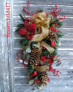 Christmas Swag with large pine cones. Like how the ribbon swirls in & out of this arrangement of 3 lg cones.