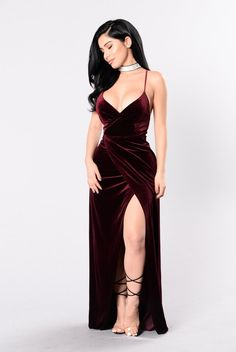 - Available in Burgundy - V Neckline - Criss Cross Back - Thigh High Slit - Maxi Length - Velvet - 90% Polyester 10% Spandex