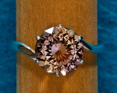 Ametrine Ring by janeysjewels on Etsy (amazing stone, natural blend of February amethyst and November citrine)