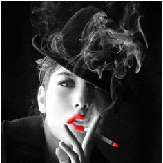 Beautiful woman smoking a cigarette  colors   http://socialsmoking.com if you smoke.