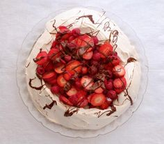 This chocolate chip-studded pavlova is like an oversized version of the meringue cookies many families serve at Passover. While it may seem fussy, heating the oven to 300° F before lowering it to 250° F helps ensure that the pavlova develops a crunchy exterior and a delightfully chewy interior. This dish is traditionally topped with whipped cream, but when you're trying to stay dairy-free, a heap of fresh berries and a generous drizzle of melted chocolate are a wonderful alternative.