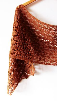Autumn leaves is a rectangular wrap worked in delicate chevron stitch. Beautiful texture and fine yarn make this scarf a perfect accessory for the early fall.
