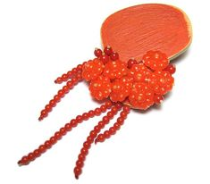 Melinda Young - Spurt Brooch. Coral, Plastic Costume Jewellery, Wood, 925 Silver, Paint. Photo from http://www.fingers.co.nz