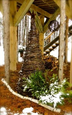 """DIY All-Seasons Grapevine Tree - Use 3-1""""x1"""" wood cut to the desired height to form a tepee shape & secure at the top with wire. Beginning with the thickest grapevines, start at the bottom & make your way to the top. You will need to wire the grapevine to the tepee & to itself to keep it uniform & secure. Add lights & decorations according to the season. Would be darling in various sizes all grouped together!"""
