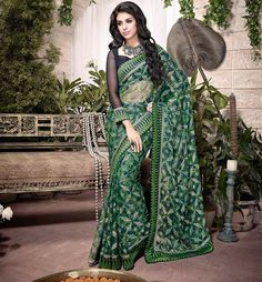 EYE-CATCHING GREEN  ART SILK SEMI CASUAL SAREE  Rock your Every-day routine with this new range of designer sarees collection. This saree is crafted from Green Art-Silk Material and lovely design is printed for greater effect. A patch border is given for added charm. A complementing blouse completes the look.  This saree is also suitable for small family gatherings.