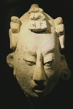 Ancient Mayan stucco head, Classic Period (300-900), originates from the Usumacinta region. Courtesy & currently located at the Musées Royaux d'art et d'Histoire, Brussels, Belgium. Photo taken by Michel wal.