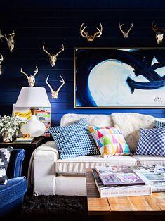 Beautiful portfolio of photographer Brittany Ambridge #dark #blue #sofa #wall #decor #white #cushions #colorful #living #Room #design #idea #american #style #lamp #painting