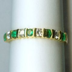Lovely yellow gold diamond and emerald wedding ring. Available at Argo & Lehne Jewelers.
