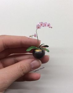 Orchid by Lamis Miniatures in a Black and Gold miniature vase by Troy Schmidt - Red Dragon Pottery 1/12 scale Dollhouse miniature