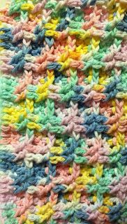 Crocheted dishrag - fun stitch that gives a nice texture.  It feels nice in your hand.  Made with 100% cotton yarn.