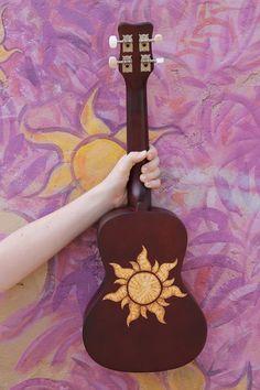 This Tangled inspired ukulele was created by wood burning the design onto the surface. It is a fully functioning ukulele and is made to order. The ukulele in the image is not the exact ukulele you will receive but will have the same design. Ukulele Art, Guitar Art, Ukulele Drawing, Ukulele Chords, Guitar Tips, Music Guitar, Rapunzel, Ukelele Painted, Painted Guitars