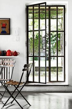 Doors to the backyard made of windows