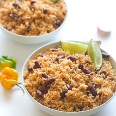 Caribbean Rice and Beans Caribbean Rice and red Beans- Seasoned with garlic and onions and creole spice. Infused with bay leaves, thyme, Scotch bonnet and coconut milk. Jamaican Dishes, Jamaican Recipes, Rice Recipes, Vegetarian Recipes, Cooking Recipes, Cooking Kale, Cooking Tips, Easy Recipes, Healthy Recipes