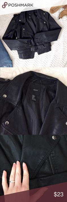 """Black Faux Leather Jacket w/ Waist Buckle Faux leather • Black with a satin finish • Has a few tiny discolored marks on the sleeves and lapel, but it's barely noticeable and could probably be removed with water and a soft cloth • Worn 3 times • Has button tabs on the shoulders, an attached belt with buckle, zip up pockets, zippers on the sleeves, and a frontal zipper • Size small • Measurements: Shoulders: 15.5"""" straight across. Arm length (armpit to wrist): 16.5"""". Waist: 16.5"""" straight…"""