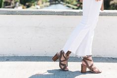 Brown lace up sandals and cropped white jeans @thestyleeditrix
