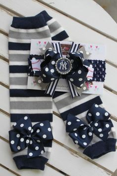 New York Yankees Leg Warmers and Bow Headband -- Bow Leg Warmers for baby girls -- navy, gray and white stripes with navy polka dot bows. $26.95, via Etsy.