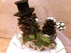 I love this topper a little more simple with our first name first letters and a heart with a veil on the bride pine cone