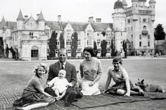 The Royal family (that's Prince Charles on the right!) poses for a photo on the Balmoral Castle estate in 1960. The corgis aren't in the loop about the posing part – notice how one is hidden behind Queen Elizabeth.