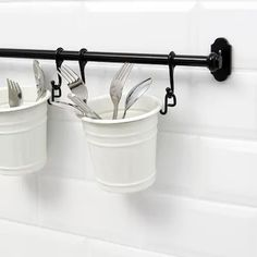 IKEA - FINTORP, Utensil holder, Helps free up space on your countertop while keeping cooking utensils close at hand.Can be hung on FINTORP rail using FINTORP hooks, or kept freestanding on the table or windowsill. Silverware Holder, Kitchen Utensil Holder, Wall Organization, Wall Storage, Ikea Storage, Organizing Ideas, Kitchen Shelves, Kitchen Storage, Kitchen Organizers