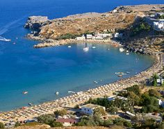 Rhodes Island, Greece. We visited when I was 8. The water was warm and crystal clear, we saw sea turtles and could dive to the bottom of the sea. Very historical, pretty island.
