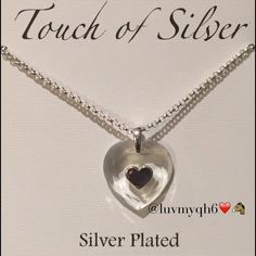 """Touch of Silver Heart Pendant Necklace This polished pendant necklace from """"Touch of Silver"""" features a Heart shaped Crystal Pendant marked by a cutout heart motif. Crafted in silver-plated metal. Approximate length: 18 inches. Approximate drop: 3/4 inch. There are (3) available! PLEASE DO NOT PURCHASE THIS POST since there are more than one available! If you would like to purchase one, Please Tag me and I will make a special post for you! Thank you! Jewelry Necklaces"""