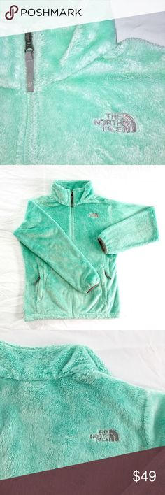 The North Face Fleece zip up. Size XS OR S woman. The North Face Fleece zip up Girl xl (18), would fit xs or small woman. See the tag photo. The color is a pretty mint with grey zipper pulls. Fluffy and soft. Photos show color, cuffs, and zipper detail. Emblem on the back and front. Any abnormalities in the fluffiness of the fleece are due to my handprints while folding. Comes from a non-smoking home. The North Face Jackets & Coats