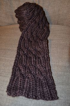 Here's my free pattern for a quick and easy cabled scarf. It's an easy chart with an easy cable. Only took a couple days to finish!  http://www.ravelry.com/patterns/library/quick-and-easy-cabled-scarf-2