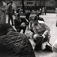 VIVIAN MAIER  Chicago (People Crouching in Daley Plaza), 1970s  For more information contact: The Jeffrey Goldstein Collection