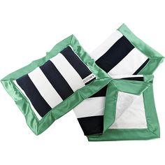 Keep your baby cozy, comfy, and completely stylish with this fashionable stroller blanket and pillow set from Oliver B. Featuring navy and white striping with Kelley-green trim, the faux-mink backing provides a soft, snuggly way to take baby on the go.