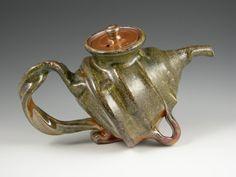 Wheel-thrown; Gold shino glaze; holds 5 8 oz. cups; Teapot