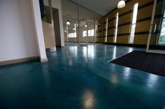 St Phillips College, by Honestone using Ardex polished  cement panDOMO Floor.