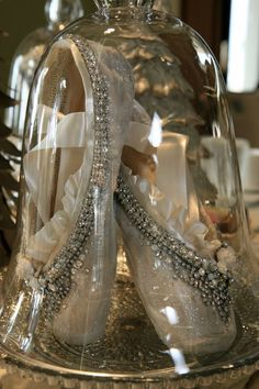 Pointe shoes decorated with glitter, vintage finds and Swarovski crystals.