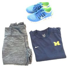 """Nike Fit Dry Michigan shirt Nike Fit Dry shirt. Size small. Navy blue with a yellow University of Michigan """"M"""" logo. No rips, stains or tears. Only sign of wear is slight spot rubbing off on the Nike swoosh. Runs a little small, which is why I am listing. Barely worn. Freshly washed. Nike Tops Tees - Short Sleeve"""