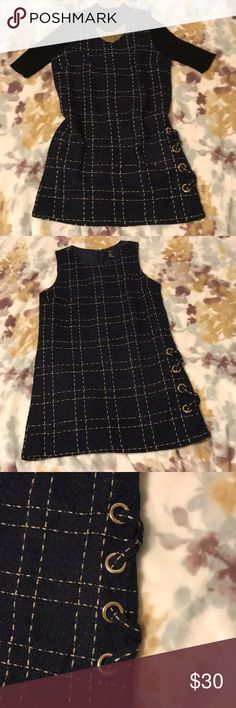 Navy and gold shift dress Tweed shift dress with lining. Gold thread running throughout. Two x shape details on bottom of one do use. Zipper up the back. Pair with an under sweater and gold jewelry for a completed chic look. Forever 21 Dresses Mini