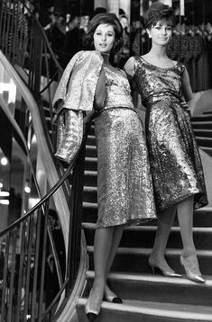 Two models sporting Chanel evening clothes in the designer's salon. 1960s
