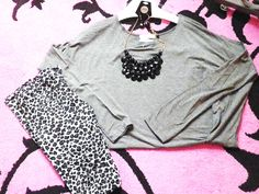 Going Fast! Black and white leopard print leggings: $21.95 Gray shirt: $31.95 Black necklace: $28.95
