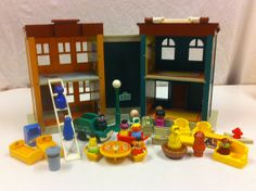 Fisher Price Little People Play Family Sesame Street. I think this is what I had as a kid