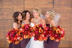 8 piece wedding bouquet set. These bridal bouquets are a wonderful vibrant presentation of reds & oranges. The calla lilies & orchids are