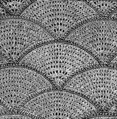 Knitted motifs in a shell shape for making bedspreads