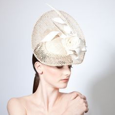 Una | Floral mesh disc with angular feather and twist (side view) | Jane Taylor Millinery | Spring-Summer 2015 | Elegant mesh saucer disc with angular printed feather, delicate rose and twist detail
