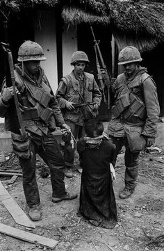 US Soldiers tormenting a civilian in the old city of Hue during the offensive, Tet, Hue, 1968