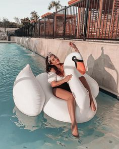 The makeover your pool has been waiting for. Make the sunny season one to remember with Sunnylife's Insta-famous floats. Inflate your summer and take it to luxe level - climb aboard the Swan Luxe Ride-On Float. Sunnylife, Paradise Found, Sunnies, Sunglasses, Shades