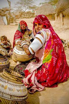 Pot making Photo by sai priya — National Geographic Your Shot - Rajasthani women painting the pots
