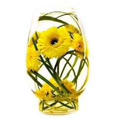 A tall glass vase encapsulating the inner beauty of yellow Gerber.